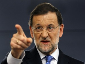 Spain's PM Rajoy gestures during a news conference at Madrid's Moncloa Palace